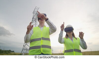 Energy engineers use virtual reality glasses to control the...