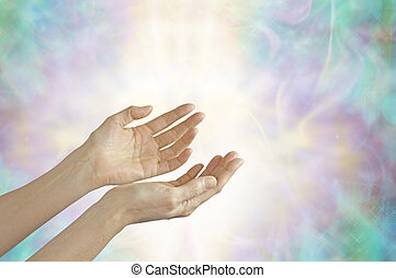 Energy Healer with open hands and shaft of light