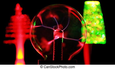 Energy lines move inside plasma ball, behind in defocusing two decorative lamps