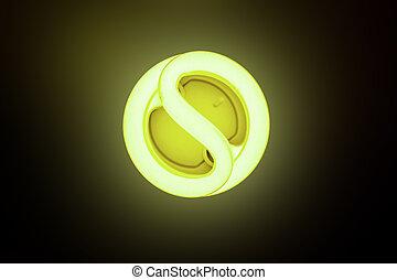 Energy saving - Included energy-saving lamp on a dark...