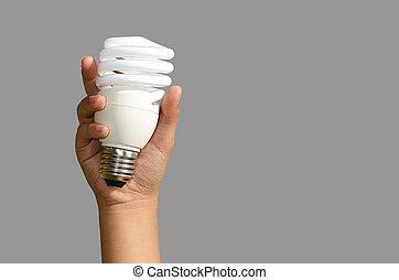 Energy saving lamps - Energy saving light bulb with a gray...