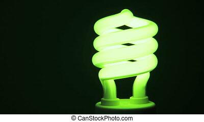Energy saving light bulb lighting up