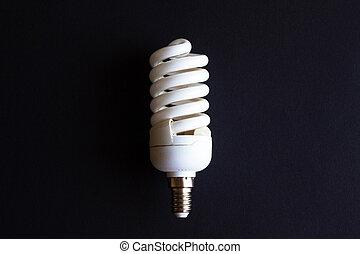 energy saving light bulb lamp on black background