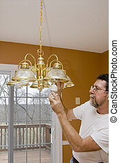 Energy saving light bulbs - Home owner install energy saving...