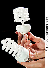 energy saving lightbulb in hand