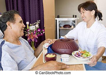 enfermeira, servindo, um, paciente, um, refeição, em, seu,...
