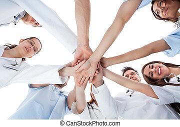 enfermeiras, empilhando, doutores, mãos