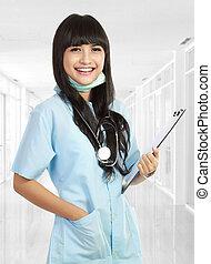 Enfermera, sonriente, médico, estetoscopio