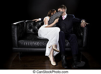 Engaged Couple Hiding Behind a Vintage Fan