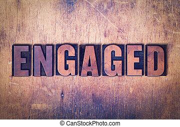 Engaged Theme Letterpress Word on Wood Background
