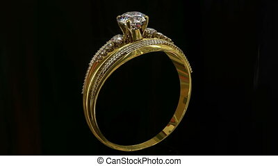 Engagement gold ring with jewelry gem rolling . - Gold ring...