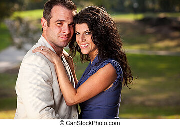 Engagement Portrait - A couple posing for an engagement ...