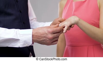 close up of man giving diamond ring to woman - engagement, ...