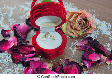Engagement ring, box, roses, rose petals