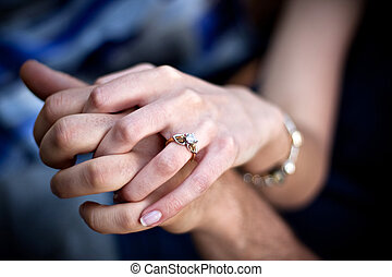 Engagement Ring Couple - Close up of a young couples hands...