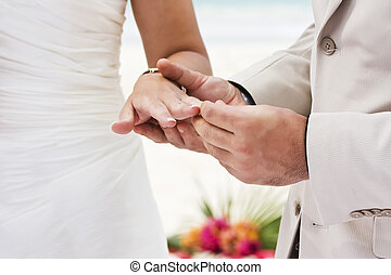 Engagement ring - Groom giving an engagement ring to his ...