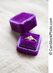 Engagement ring in the box on gray background