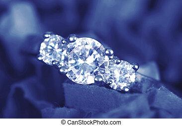 Engagement Ring taken closeup on blue