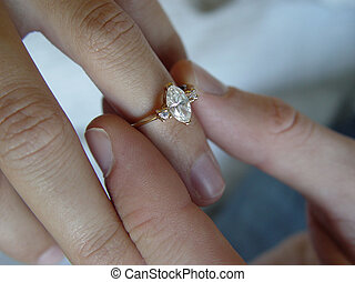 Engagement Ring - This is a ring being placed on a girls...