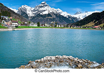 Engelberg - Pond on the Background of Snow-capped Alps,...