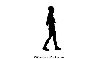 Engeneer girl in a helmet and with headphones on her neck goes . Silhouette. White background . Side view