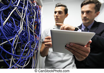 Engeneers in network server room