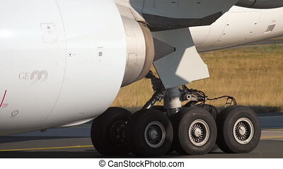 Engine and gear of airplane close up