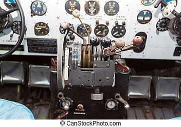 Engine Controls in the cockpit of an old airplane