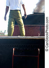 Engine driver on Steam train in Valle de los Ingenios, Cuba...
