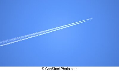 Engine exhaust contrails forming behind flying commercial...