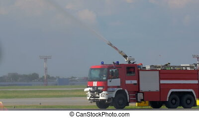 Engine fighting the airplane fire - Fire fighting vehicle...