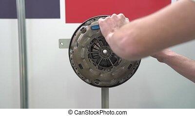 Engine flywheel repair at service station internal parts of machine vehicle motor camera movement