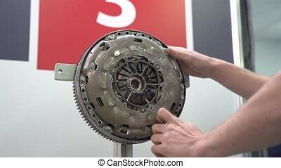 Engine flywheel repairs at service station internal parts of machine vehicle motor camera movement
