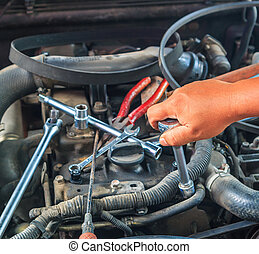 Engine mechanic working in auto repair shop