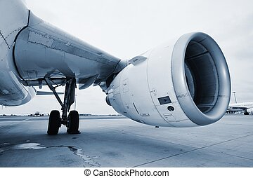 Engine of the airplane at the airport.