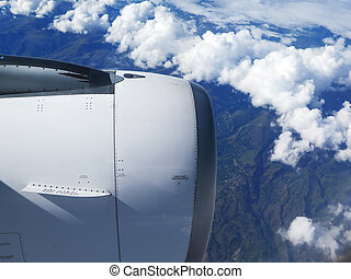 Engine of the plane on blue sky background