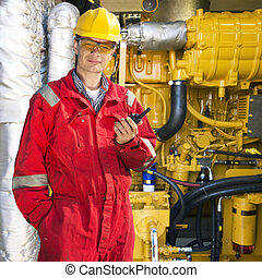 Engine room engineer - Engineer, wearing overalls, hard hat...