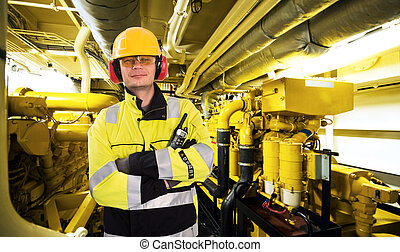Engine room worker - Proud mechanic, posing with his arms ...