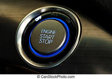 Engine start button in modern car close