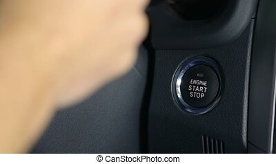Engine Start Stop Button - Stopping a car engine with start...