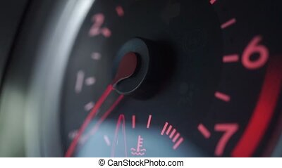 Engine starting, revving and stopping. Shallow focus close up tachometer video