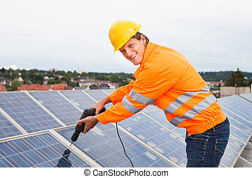 Engineer Adjusting Solar Panels