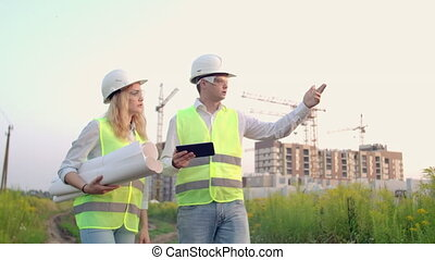 Engineer and controller go to the construction site on the...