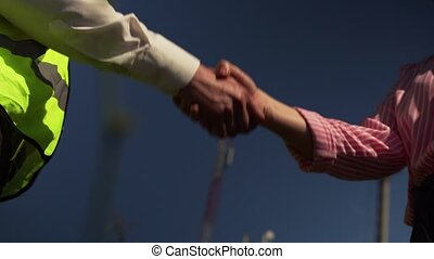Engineer And Head Of A Large Firm Shaking Hands