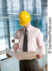Engineer at work - Portrait of confident foreman in helmet...