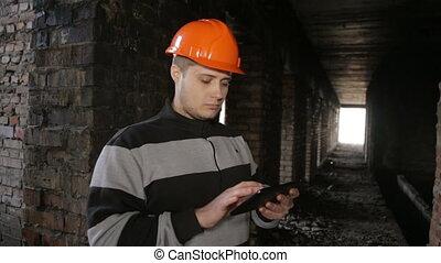 Engineer builder examines drafts on a tablet. full hd video