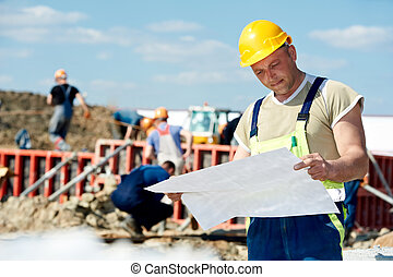 Engineer builders at construction site with draft