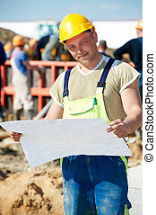 Engineer builders at construction site with draft - One ...