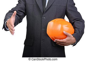 Engineer - Businessman in helmet offering handshake over...