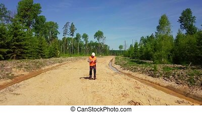 Engineer check new forest road